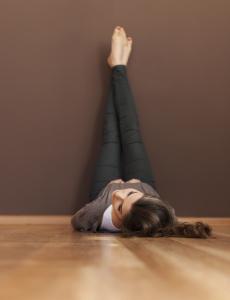 Young woman relaxing on hardwood floor