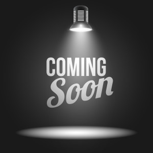 Coming soon message illuminated with light projector blank stage realistic illustration