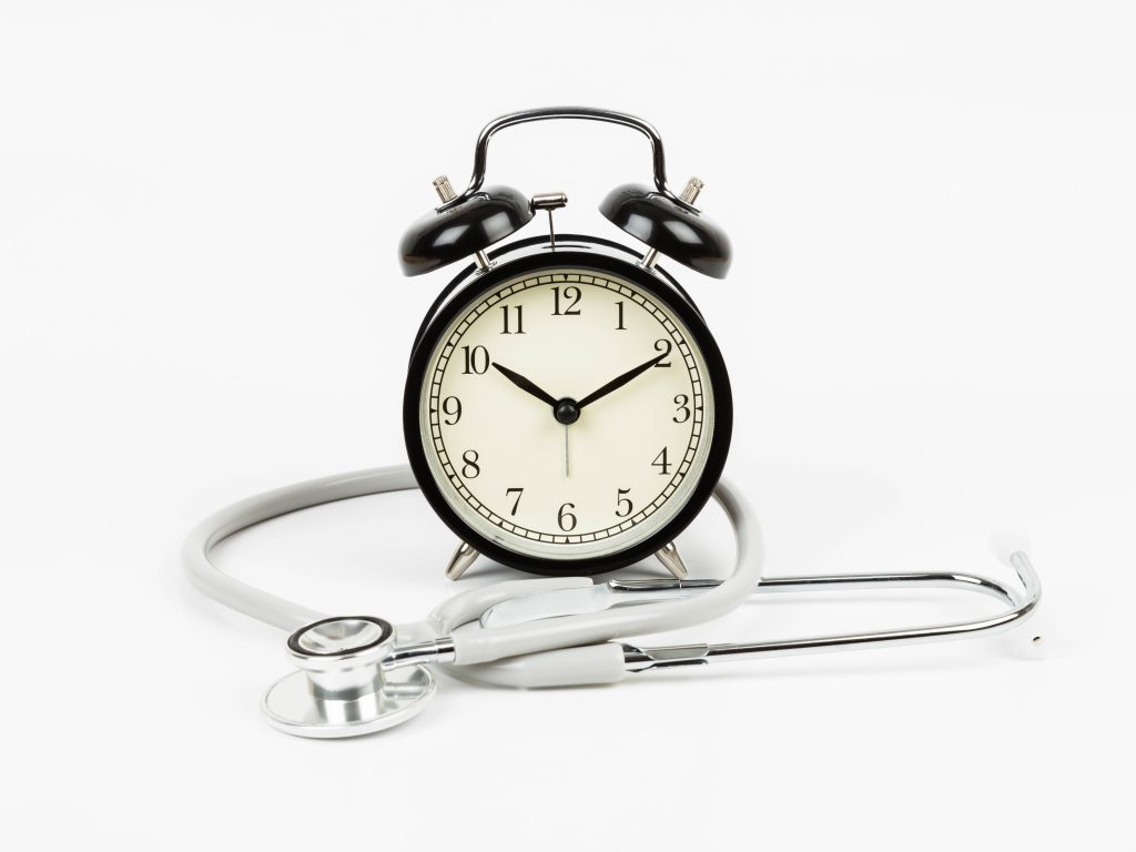 Alarm clock with stethoscope concept healthcare time